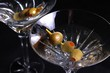 Two martini glasses with olives
