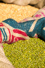 Green mung beans in canvas sack background