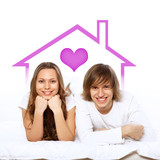 Young couple in white with heart symbols