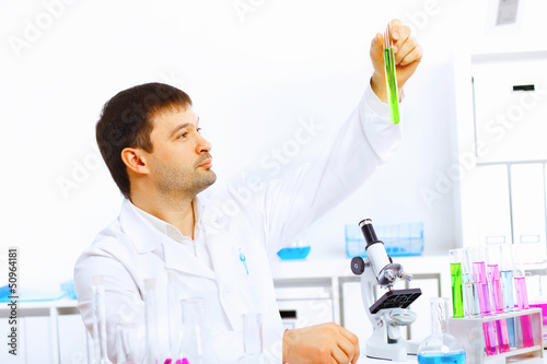 Young male scientist working in laboratory