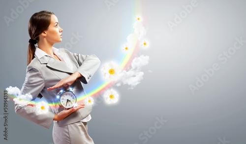 Businesswoman holding alarmclock