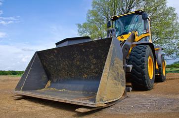 Yellow bulldozer at a construction site