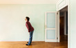 portrait of a weird guy in a room with the door open