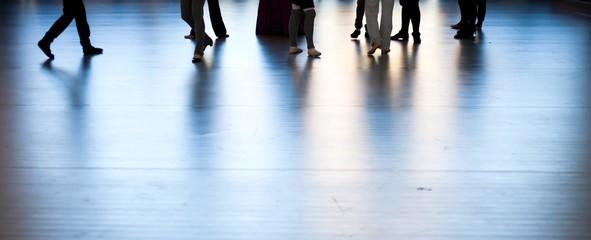 Women dancing feets reflected on floor