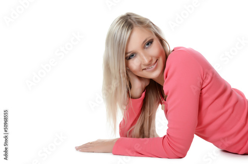The beautiful young woman smiles isolated on white background