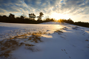 snowy hill at sunset