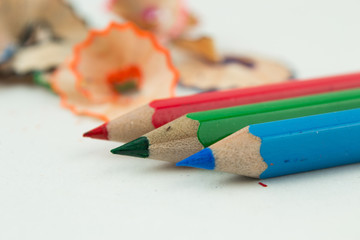 Colored pencils and shavings  isolated on a white background