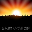 Sunset above city silhouette