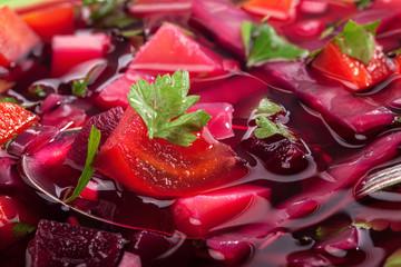 Ukraine cuisine, beet soup - borsch, closeup