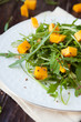 salad with chunks of pumpkin and green