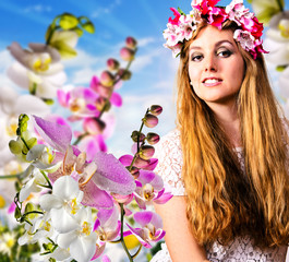 Beautiful Woman With Orchid Flowers and Floral Wreath