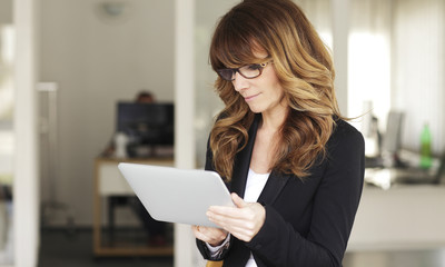 Mature Businesswoman with Digital Tablet