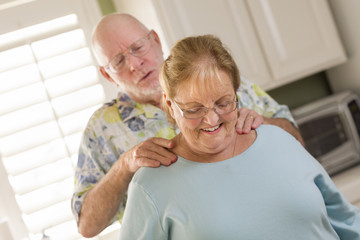 Senior Adult Husband Giving Wife a Shoulder Rub