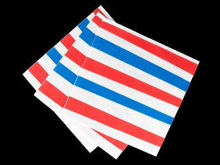 Red white and blue striped natpkins, serviettes - isolated