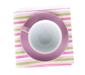 Coffee cup over kitchen towel