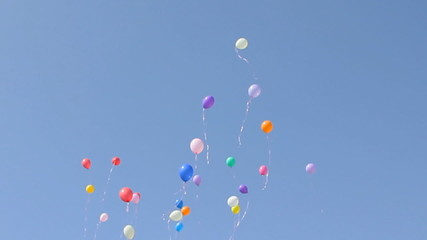 colored balloons fly in the sky. children's Holiday