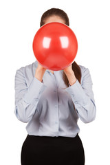 Girl in a gray shirt holds a balloon inflated