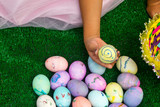 Girl counting Easter eggs