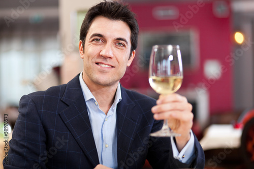 Man toasting wine in a restaurant