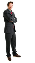 Full length businessman with folded arms