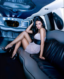 Beautiful girl in the limousine
