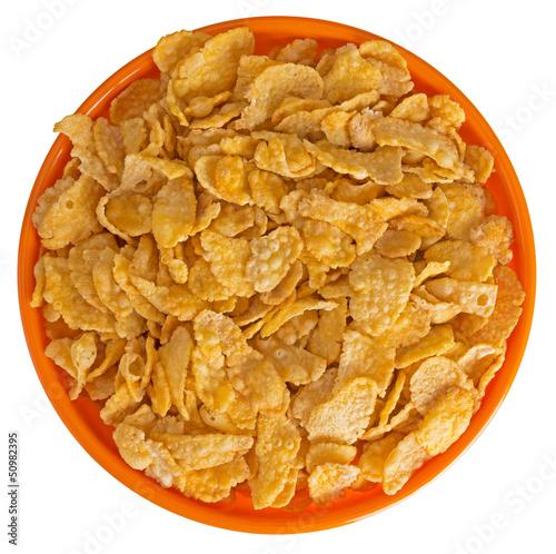 Sunshiny orange bowl of breakfast cereal cornflakes, isolated ov
