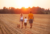 happy family with dog walking