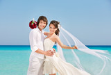 happy bride and groom at the beach