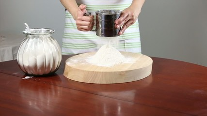 Sifting flour with a sift.
