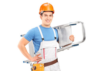 A manual worker with a helmet carrying a ladder