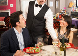 Waiter serving sea food