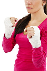 Young boxer woman with white bandage on hands