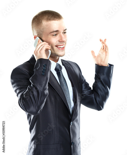 Portrait of handsome young business man using cell phone