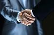 Leinwanddruck Bild - Handshake - Hand holding on black background