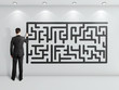 man drawing maze