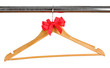 Beautiful red bow hanging on wooden hanger isolated on white