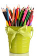 Colorful pencils and felt-tip pens in green pail isolated