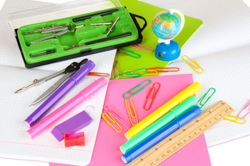 Various school supplies close-up isolated on white