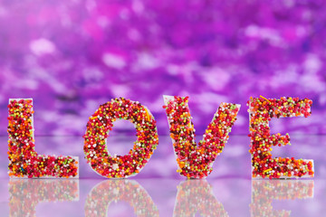 Word Love on purple background