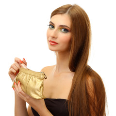 Beautiful young woman with cosmetics bag and lipstick