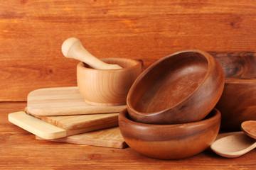 Wooden kitchen utensils on wooden background