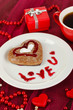 Chocolate cookie in form of heart with cup of coffee