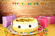 Happy birthday cake and gifts, on bright background
