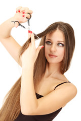 Beautiful woman with long hair and hairdresser's scissors,