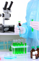 Scientist conducting research in laboratory close up