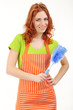 Young woman wearing apron with brush isolated on white