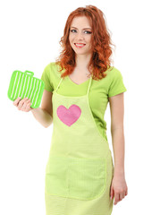 Young woman wearing kitchen apron holding potholder, isolated