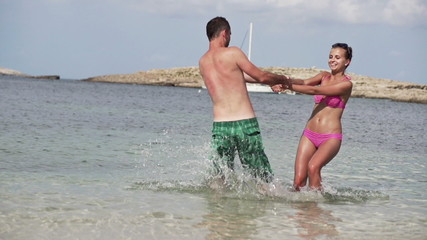 Couple playing in the sea, super slow motion, shot at 240fps