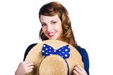Pinup girl with straw hat