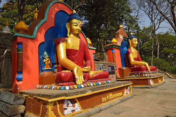 The statue of Buddha is located at the Swayambhunath Temple in N